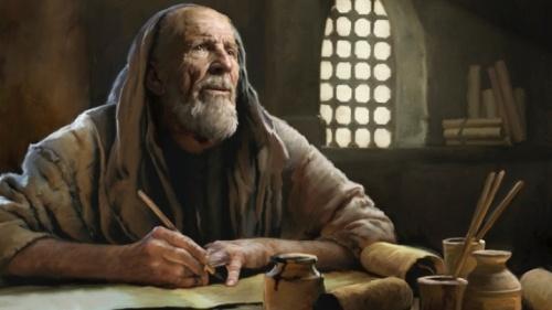 Un homme ancien écrit sur un parchemin