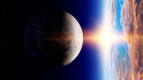 La lune et la terre et le soleil sur l'horizon